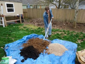 Sustainable Craig Square Foot Garden Mixing Soil