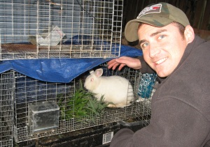 Craig feeding bamboo leaves to the rabbits