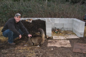 craig with compost pile and cat