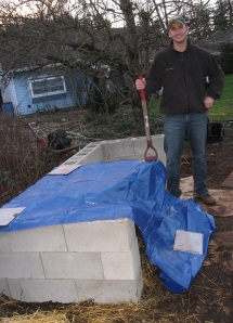 craig with compost pile and pitch fork