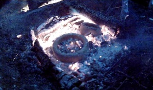 firing pots in coals